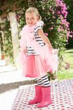 Young Girl Wearing Pink Wellington And Feather Boa Royalty Free Stock Photo