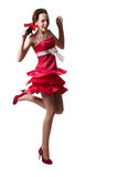 Young girl wearing a red dress is dancing isolated Royalty Free Stock Image