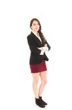 Young girl wearing red skirt and black jacket Stock Photos