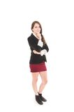 Young girl wearing red skirt and black jacket Stock Images