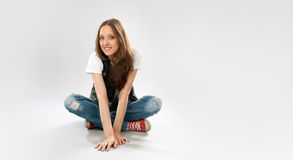 Young girl wearing red sneakers Stock Photos