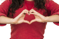 Young girl wearing red top posing making a heart Royalty Free Stock Image