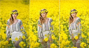 Young girl wearing Romanian traditional blouse posing in canola field, outdoor shot. Portrait of beautiful blonde with wreath Royalty Free Stock Photography