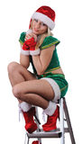 Young girl wearing santa claus clothes and high heels Stock Images