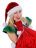 Young girl wearing santa claus clothes and winks Stock Photos