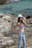 Young girl wearing shorts and crop top and hat posing outside Royalty Free Stock Photo