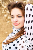 Young girl wearing spotted blouse Stock Images