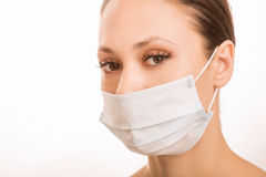 Young girl is wearing sterile face mask Royalty Free Stock Photo