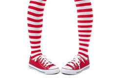 Young girl wearing striped red socks Royalty Free Stock Image
