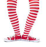 Young girl wearing striped red socks. On white background stock photography