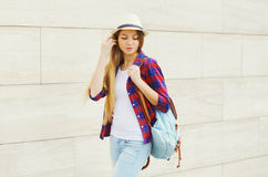 Young girl wearing a summer straw hat and checkered shirt Stock Image