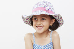 Young girl wearing sun hat, smiling Royalty Free Stock Images