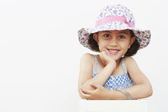 Young girl wearing sun hat, smiling Stock Images