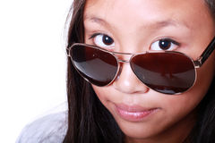 Young girl wearing sunglasses Stock Images