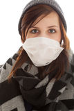The girl is wearing a surgical mask Stock Image