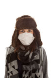 The girl is wearing a surgical mask Royalty Free Stock Photos