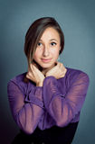 Young girl wearing violet dress Royalty Free Stock Photos