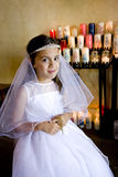 Young girl wearing white dress holding rosary Royalty Free Stock Photo