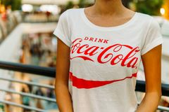Young Girl Wearing White Shirt With Drink Coca-Cola Slogan. LISBON, PORTUGAL - AUGUST 10, 2017: Young Girl Wearing White Shirt With Drink Coca-Cola Slogan Sign Stock Photo