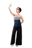 Young girl wearing wide-leg pants and off-the-shoulder top taking expressive selfie Royalty Free Stock Image
