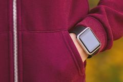 Girl wearing smart-watch on her hand Royalty Free Stock Photos