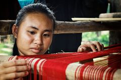 young girl weaving on a traditional loom royalty free stock photos