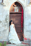 Young girl in the wedding dress Stock Photos