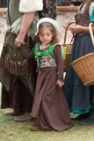 Renaissance Festival Girls. A young girl welcomes visitors to the Arizona Renaissance Festival Royalty Free Stock Photo