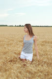 Young girl in the wheat field Royalty Free Stock Photos