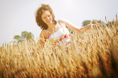 Young girl on the wheat field. Young girl enjoy at sunny day on the wheat field Royalty Free Stock Photography
