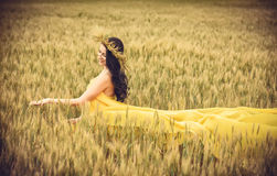 Young girl on wheat field Stock Image