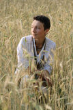 Young girl on wheat field Stock Photo