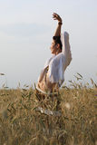 Young girl on wheat field Stock Images
