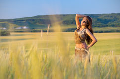 Young girl in wheat field Royalty Free Stock Image