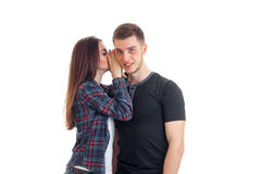 Young girl whispering guy in his ear stock photos