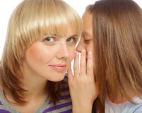 Young girl whispering secrets in her mommy's ear Stock Photos