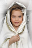 Young girl in a white cape Royalty Free Stock Photography