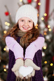 Young girl with a white Christmas heart Stock Photos