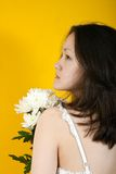 Young girl and white chrysanthemums Royalty Free Stock Photos