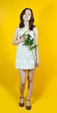 Young girl and white chrysanthemums Royalty Free Stock Photo