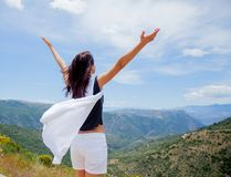 Young girl in white clothes standing on rock in Greece. With view at mountains royalty free stock photos