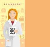 A young girl in a white coat psychologist. Stock Photography