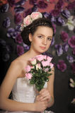 Young girl in a white dress with pink roses Royalty Free Stock Photography