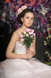Young girl in a white dress with pink roses Stock Photography