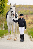 Young girl with white dressage horse Stock Photos