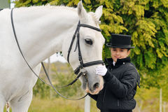 Young girl with white dressage horse Royalty Free Stock Photography