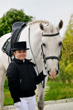 Young girl with white dressage horse Royalty Free Stock Photo