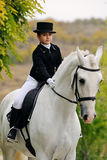 Young girl with white dressage horse Royalty Free Stock Image