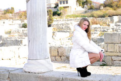 The young girl in a white fur coat Stock Photo