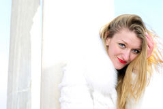 The young girl in a white fur coat Stock Image